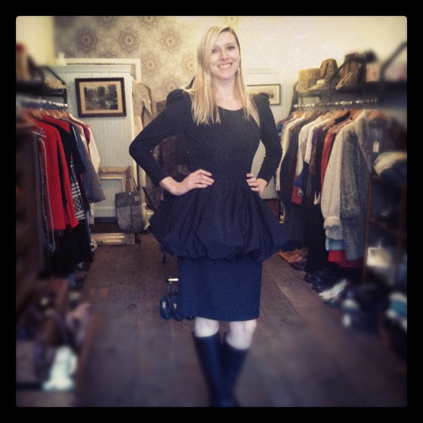This beauty from Russia modeling a 1980's peplum dress $100 (at Antoinette)