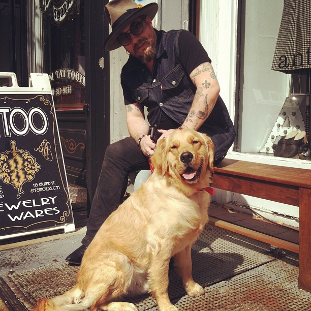 Goose the pup & his stylish Dad wait patiently while Mom shops #antoinettevintage #dogsofantoinette (at Antoinette)