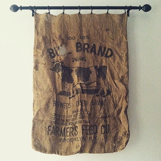 """Once upon a time, Brooklyn was one of the most significant agricultural counties in the United States."" 🐄 // Bought this Antique feedbag at a flea market Upstate this past Summer & it now hangs proudly above our bed 🐖🐓🐐 (at Casa La Kitten)"