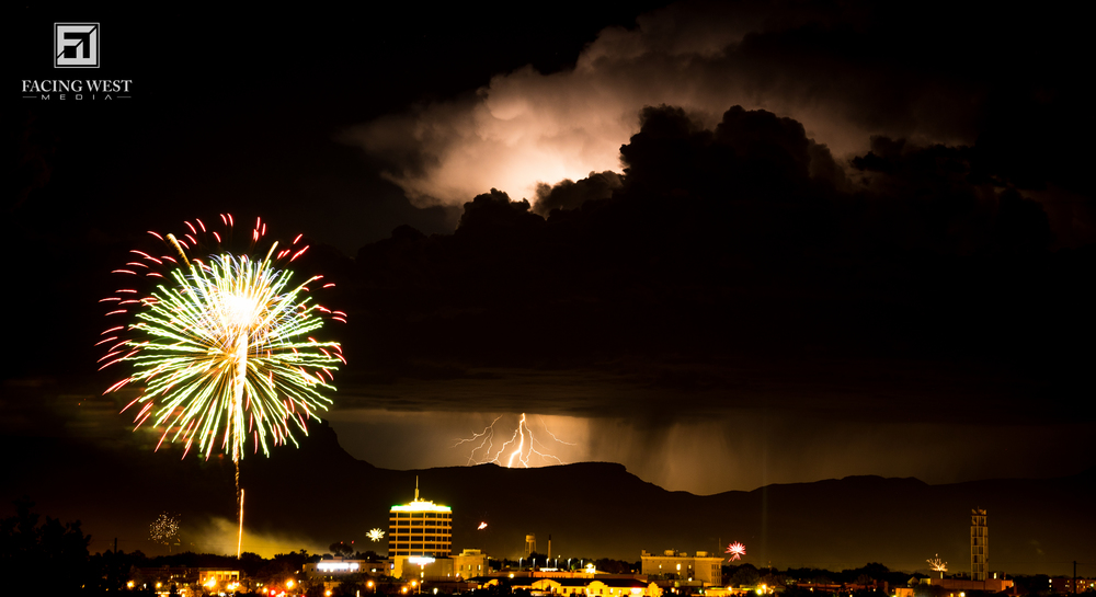 Lightning firing behind the Fourth of July fireworks display in Grand Junction CO.