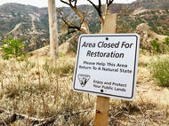 A sign on Dog Island urges campers to avoid the post-fire restoration areas.