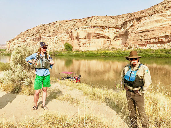 Kate Graham, assistant director of the Colorado Canyons Association, which stewards the three National Conservation Areas on the Western Slope, and Troy Schnurr, a Colorado River ranger, discuss the conservation and restoration efforts at Cottonwood Camp 5 along the Ruby Horsethief stretch of the Colorado River.