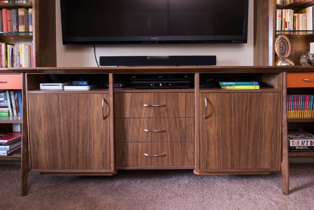 Design + Build of custom Walnut Mid-Century Inspired entertainment center.