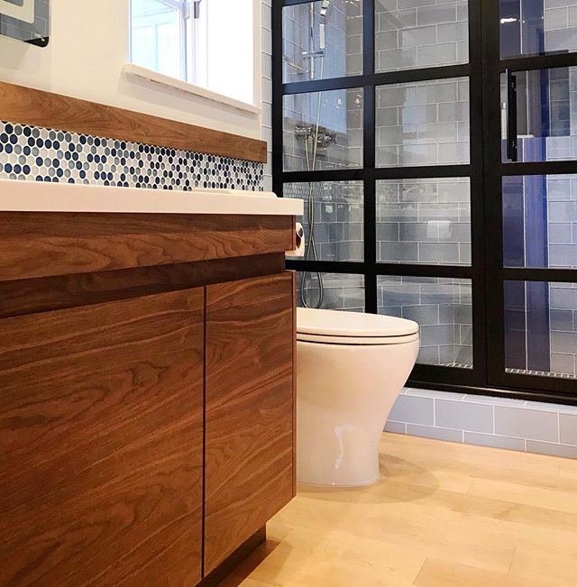 Custom walnut bath vanity with integrated pulls, for a very special boy's bedroom + bath remodel project.  #letsbuild #bathremodel #bathvanity #moderndesign #contemporary #cabinets #walnut #wood #moderncabinets #design #bathdesign #builtbyhand #madeincalifornia #fineinteriors #interiors #metal #metaldoor