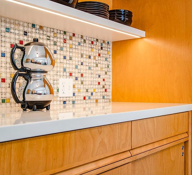 Seeing our Thousand Oaks Eichler kitchen projected featured on @theatomicranch this morning was an extra special way to start the weekend! So, we thought we'd share a few more photos.  One of our favorite elements to build were the custom integrated pulls, based on those original to the home, handcrafted in our woodshop.  Another feature we're proud of are the smooth gliding soft-close sliding doors! This cabinetry hardware allowed our client to retain the look of her original Eichler cabinetry but with increased functionality — an approach to renovation we can appreciate. 📷 @caterphotography  #builtbyhand #letsbuild #eichler #midcentury #ableandbaker #atomicranch #remodel #californialiving #kitchenremodel #wood #customcabinetry #kitchendesign #midcenturymodern #madeincalifornia