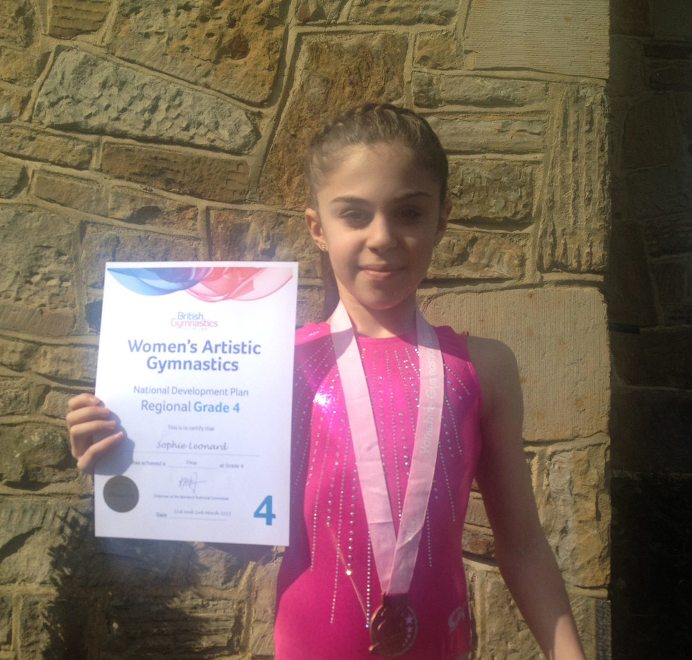 Photo: Sophie with her certificate and medal