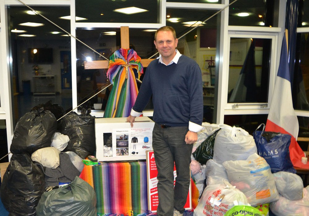 Photo: Dozens of donated items being collected by Robert Greenacre from Kos Kindness and Kos Solidarity. Thank you once again to the generosity of our school community.