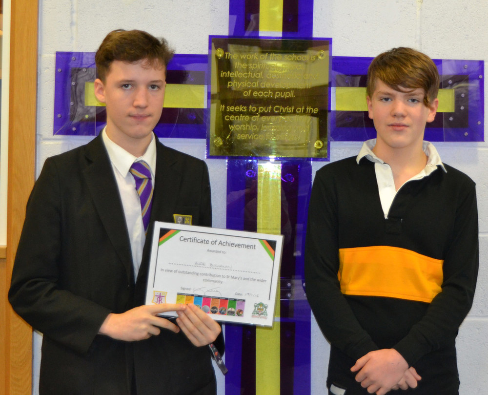Photo: Alifie (left) and Toby (right) fittingly photographed under the cross with our school's purpose on
