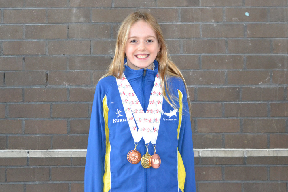 Photo: Izzy with some of her medals