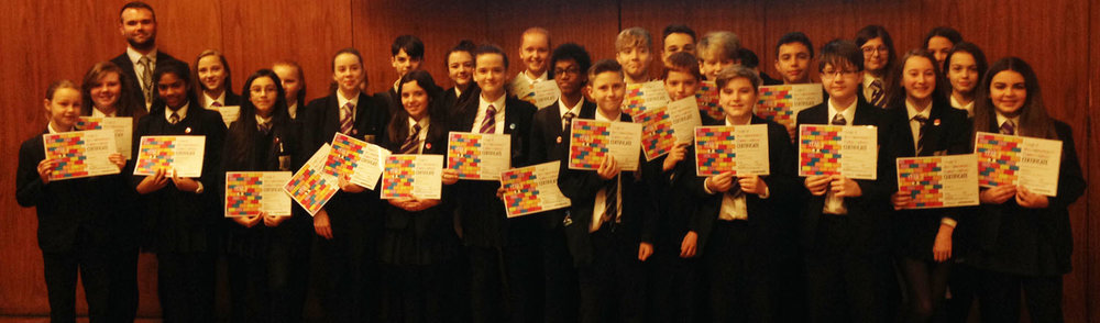 Photo: Student Progress Leader, Mr T Hamill joins students with their awards after the assembly