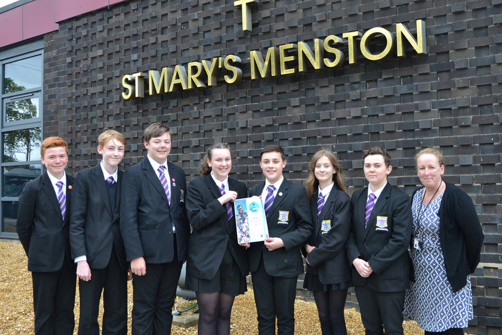 Photograph (Left to Right):  Aidan Silcock, Jack Smith-Eccles, Tom Allan, May Gavin, Sam Clifford-Hassan, Alessandra Orlandini, Ethan Walker, Mrs Hayes (Global Learning Coordinator)
