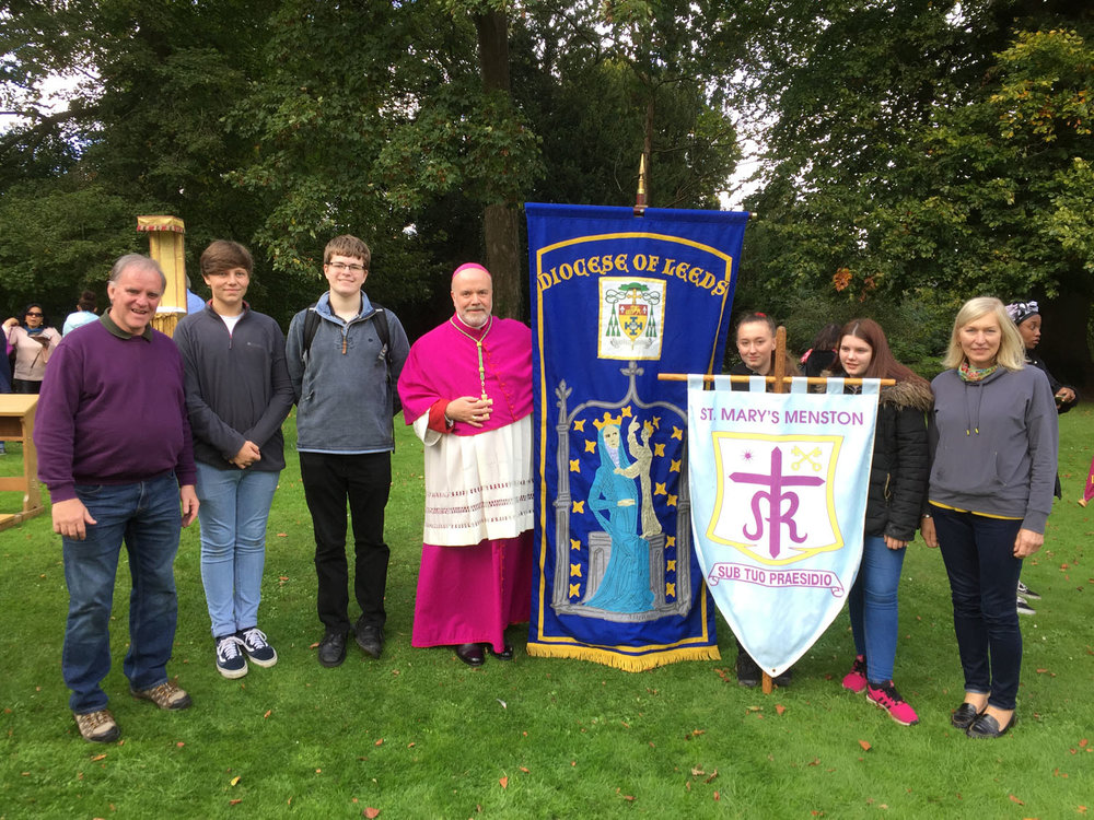 PHOTO: Left to Right: Mr Lavery, Thomas Woolston, William Inglehearn, Bishop Marcus, Charlotte Peirse, Holly Brearton, Mrs Findlay