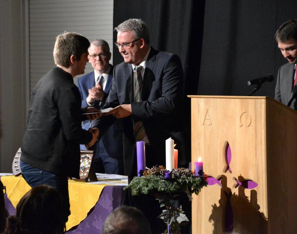Sebastian McCormick receives his award from Duncan Wood