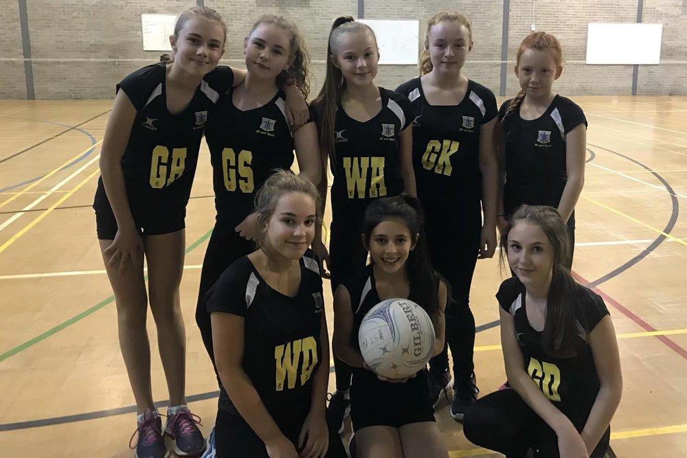 Year 8 Netball Team. L-R Back: Esme Astbury, Aoife Rowley, Annabel Down, Grace Casey. L-R front: Carys Delahay, Charlotte Rawstron, Niamh Walsh