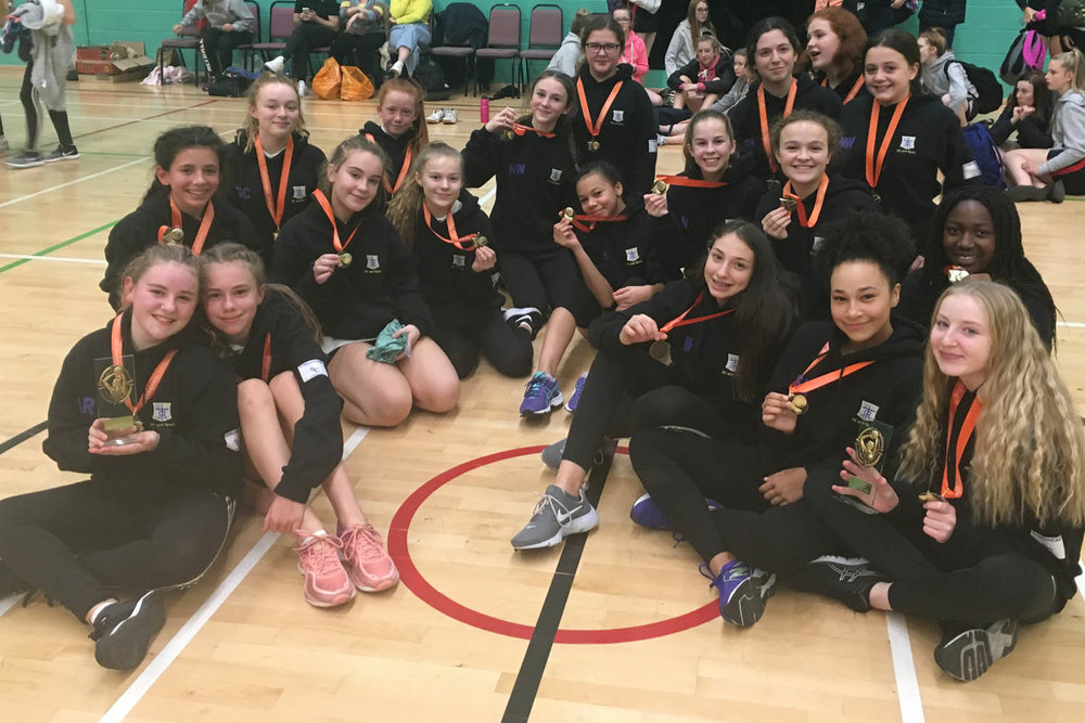 Our netballers with medals and trophies
