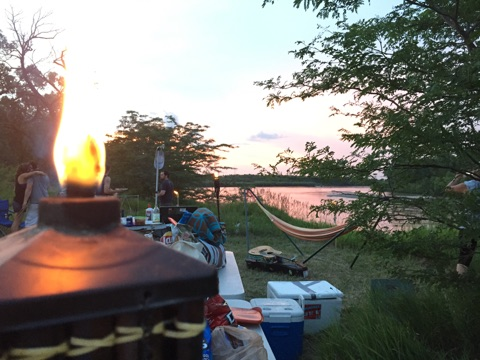 Some tiki torches, a hammock, some nice music, hugs, coolers of beer, food...pretty much everything you could ask for in 1 picture.