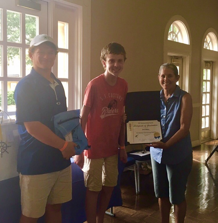 Jack Whelan receives his Brendan Diploma from Instructor Evan McCarthy and Lead Instructor Charlie Arms!
