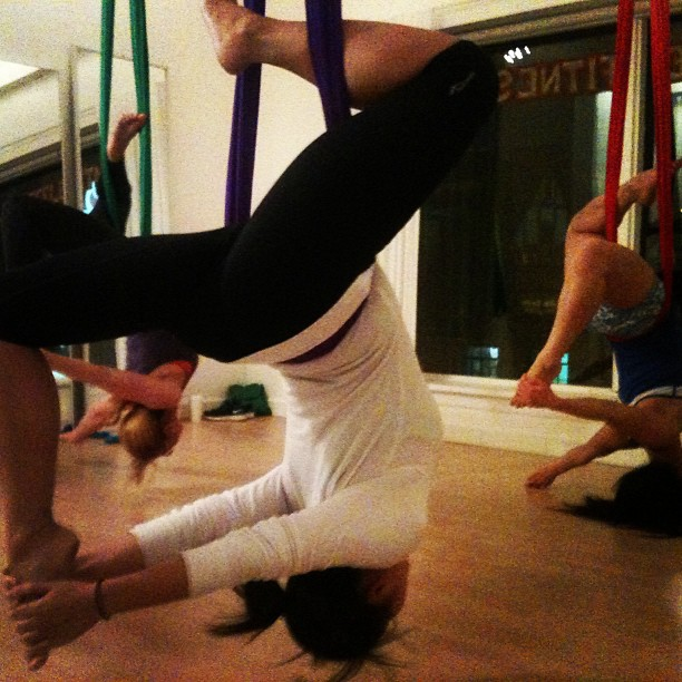 Inverted Pigeon in Aerial Yoga