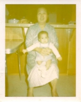Joann in her paternal grandmother's lap.
