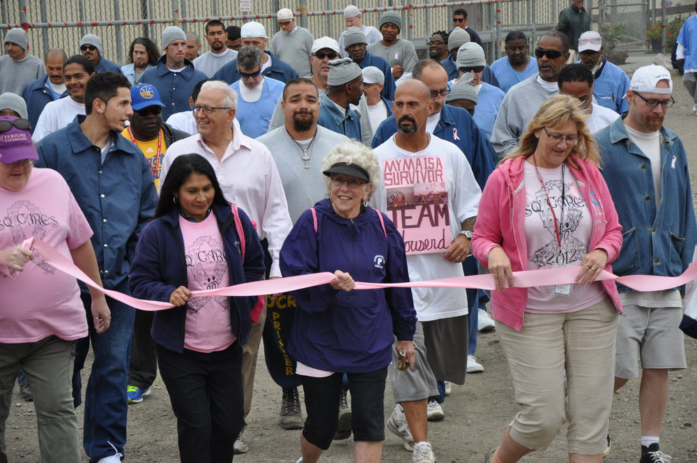 Inmates and supporters on the 2017 Breast Cancer Walk at San Quentin.