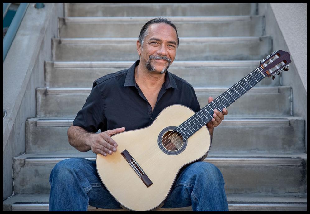 DVI arts program alumnus Robert Vincent with a guitar he made.