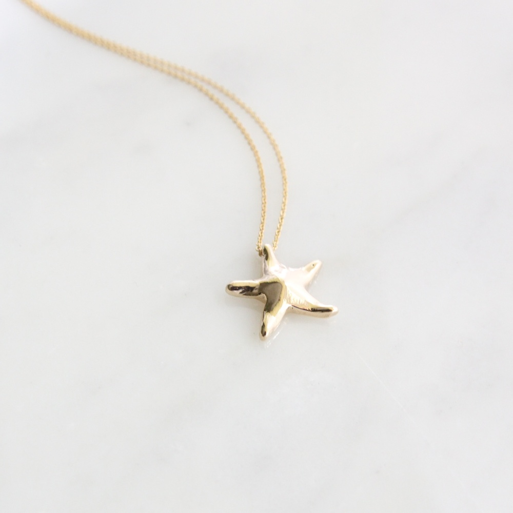 14k yellow gold hand carved starfish