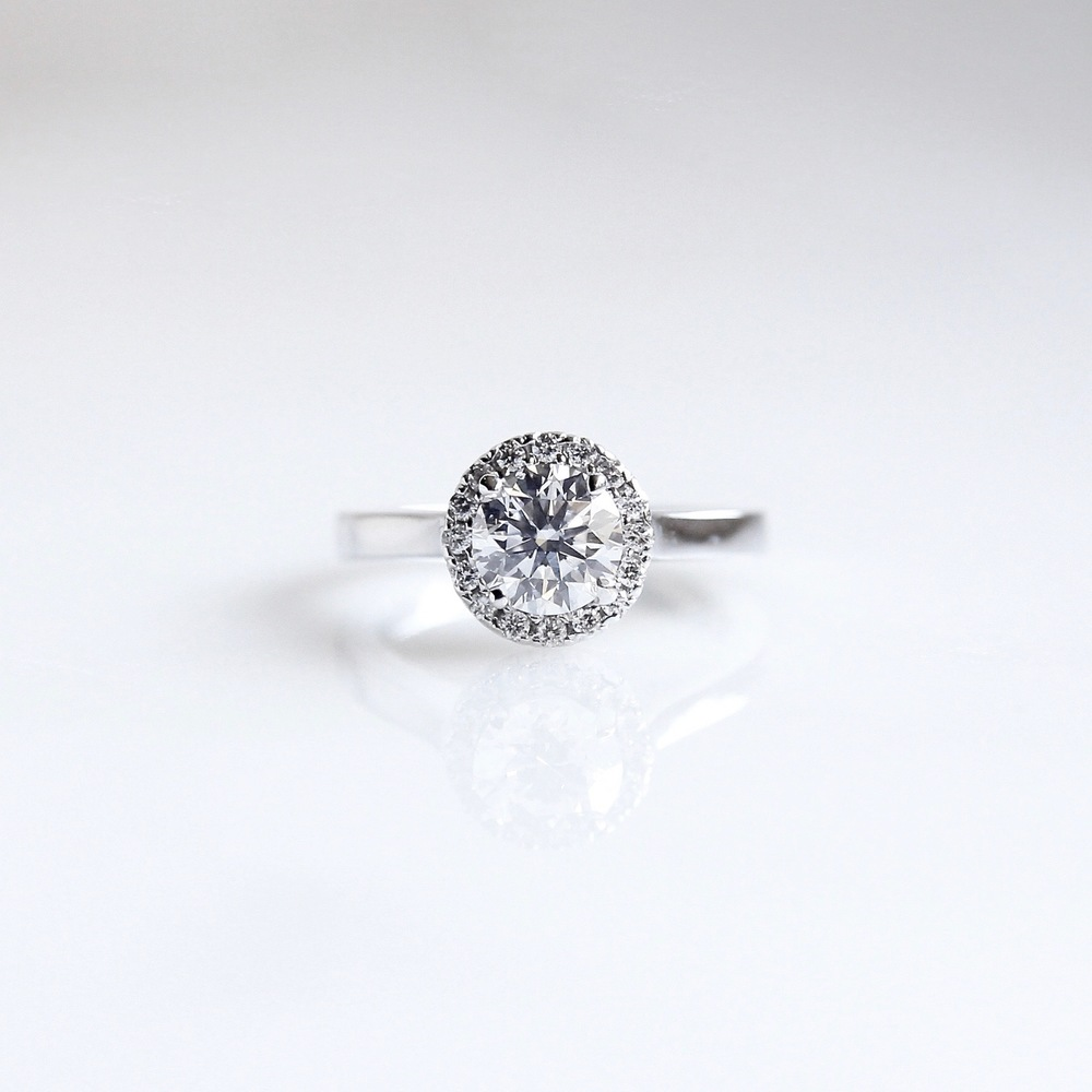 Canadian diamond centre stone with diamond halo set in 18k white gold