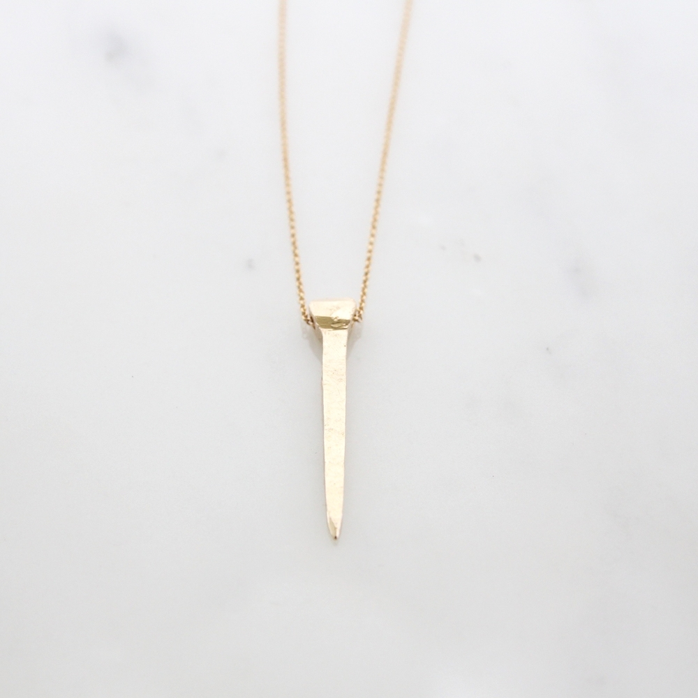 14k yellow gold hand carved horseshoe nail