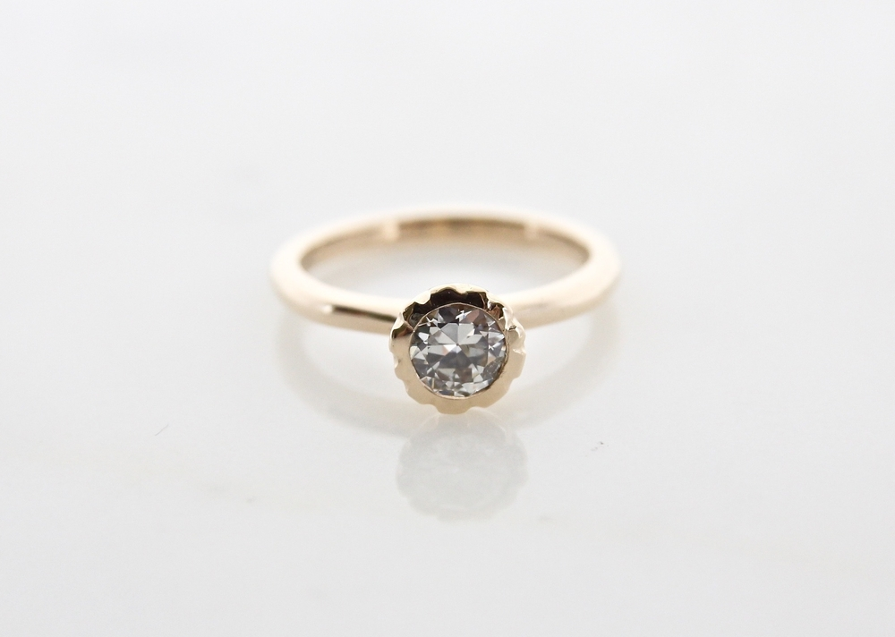 Old European cut diamond centre stone set in 14k yellow gold
