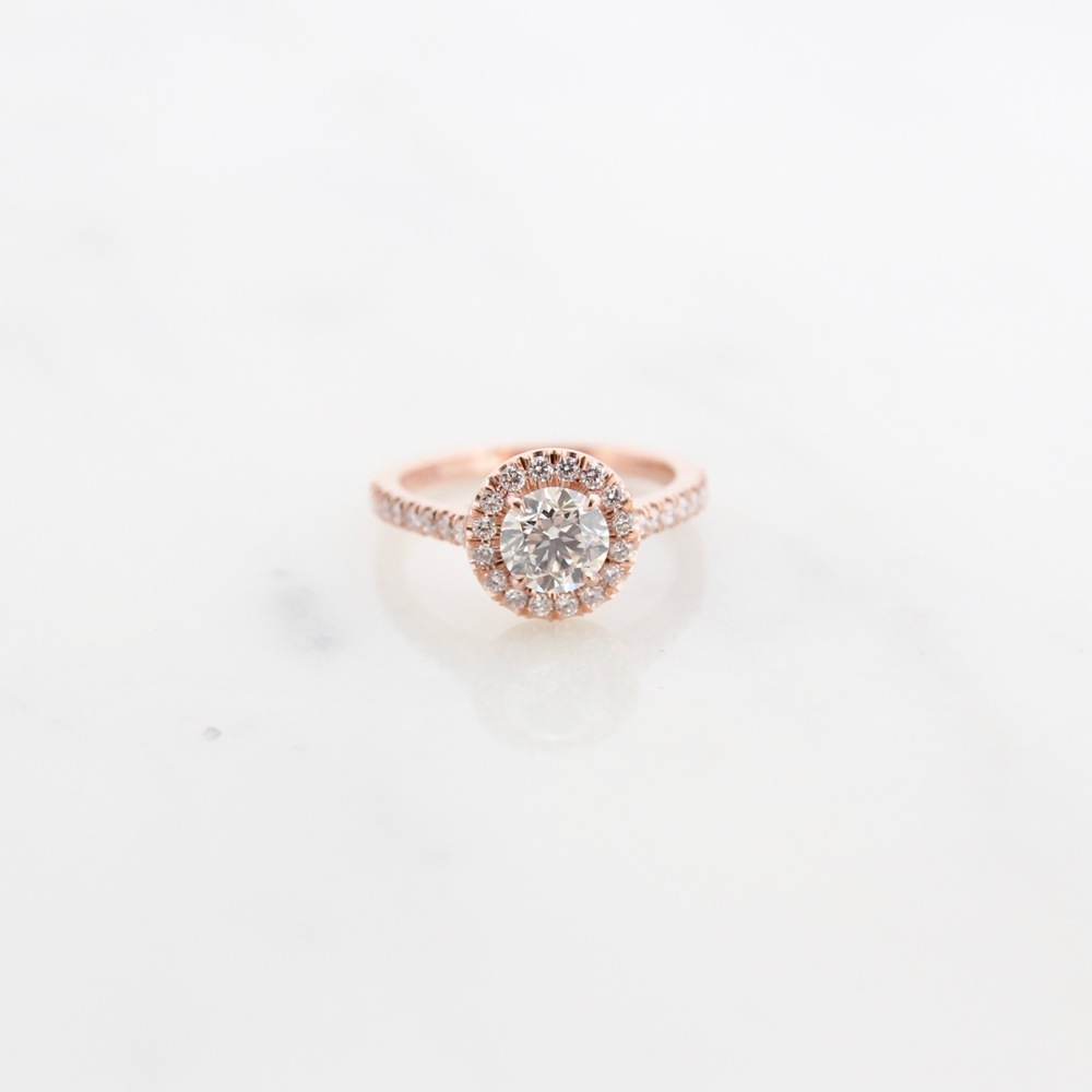 14k rose gold and diamond halo ring