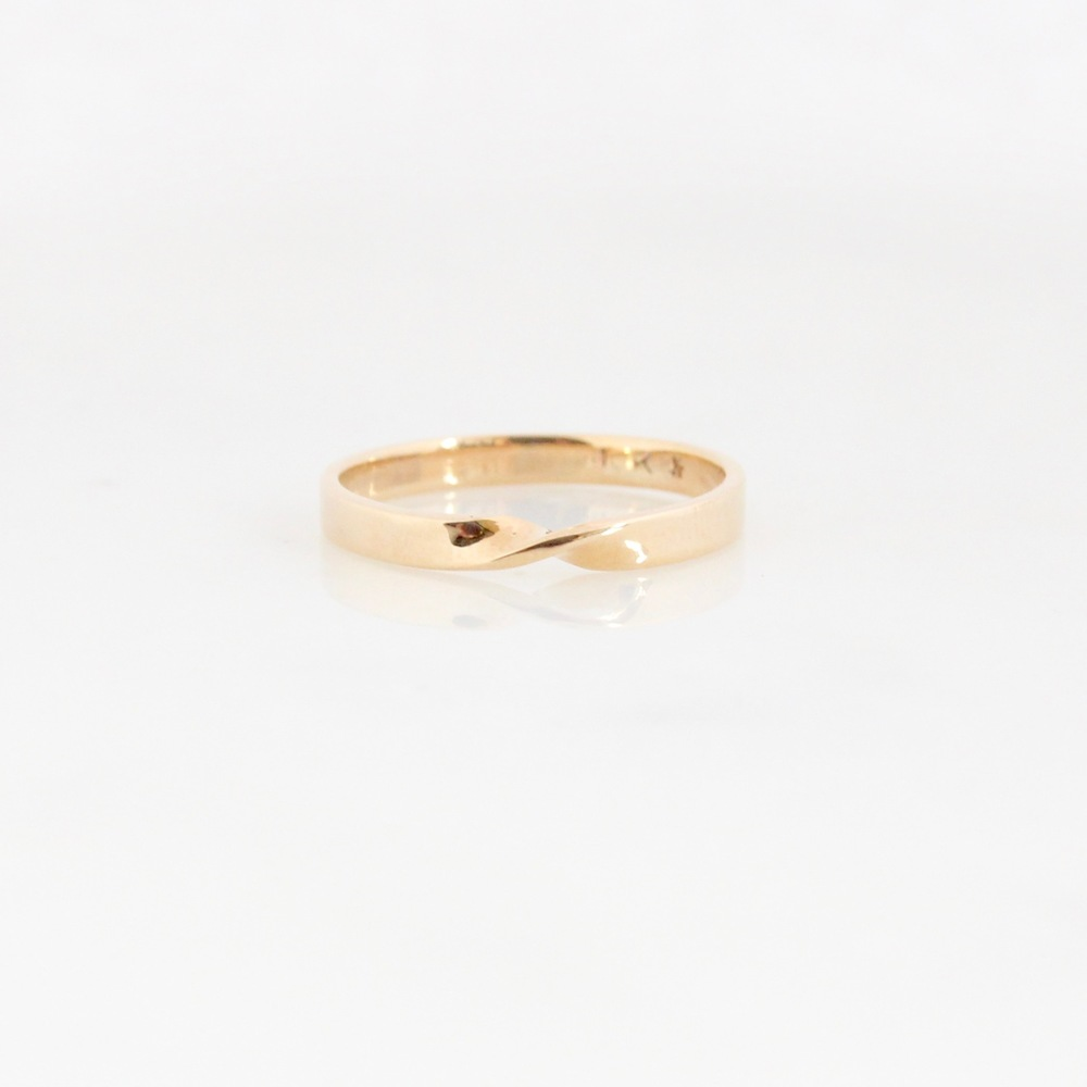 Eternity twist band 10k yellow gold