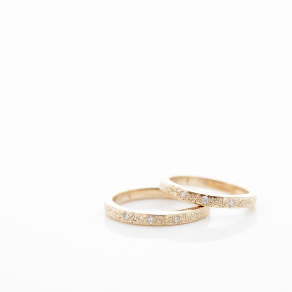 matching stardust bands 14k yellow gold with white diamonds