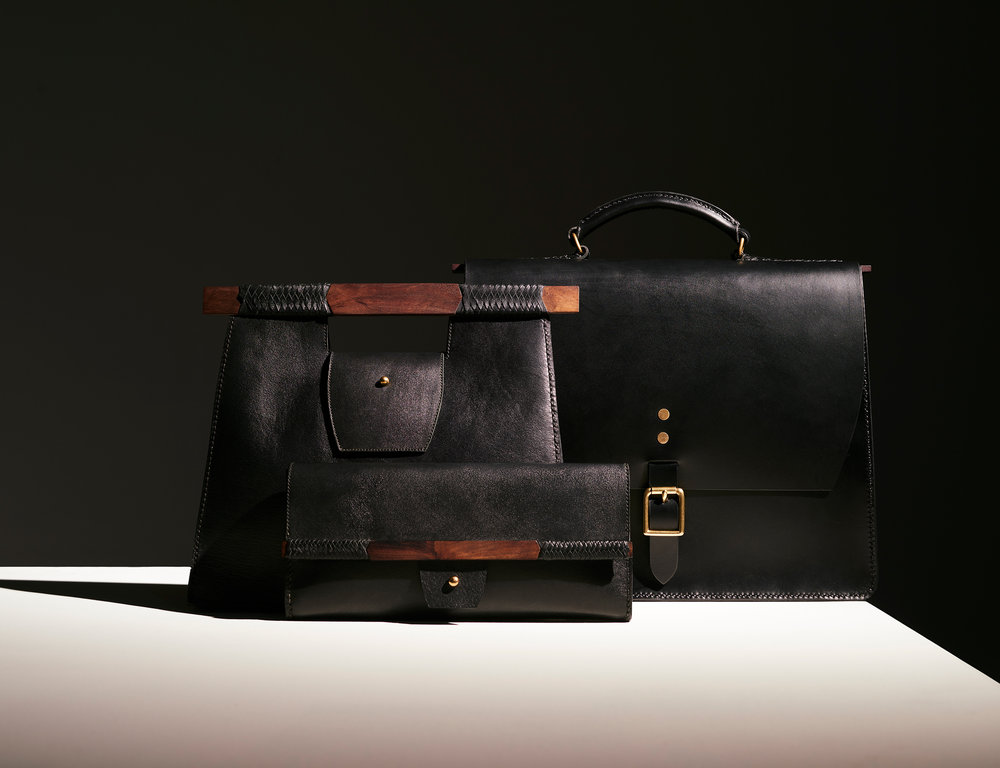 Outliers Range    In his second bag range James B. Young delivers three new limited edition styles inspired by central desert architecture and executed utilising kangaroo leather and desert timbers.  The early pastoral outbuildings in the Central Desert region were often sturdy, appropriate and made from raw materials closest to hand. Deep roof cavities formed voids to draw in cool air. Architectural silhouettes that leant in on themselves, a result of maximum strength from minimum timber. The line of the verandah sits so low the entrant must stoop to pass beneath the horizontal beam.   It is through this lens and studies in craftsmanship James B. Young delivers his second bag range. Three timeless pieces that bring together his skills as a shoemaker and fine artisan with his reflections on the ecology, heritage and traditions of Central Australia.