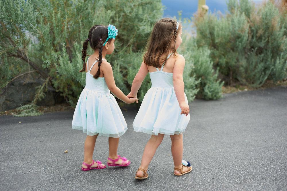 two flower girls walking