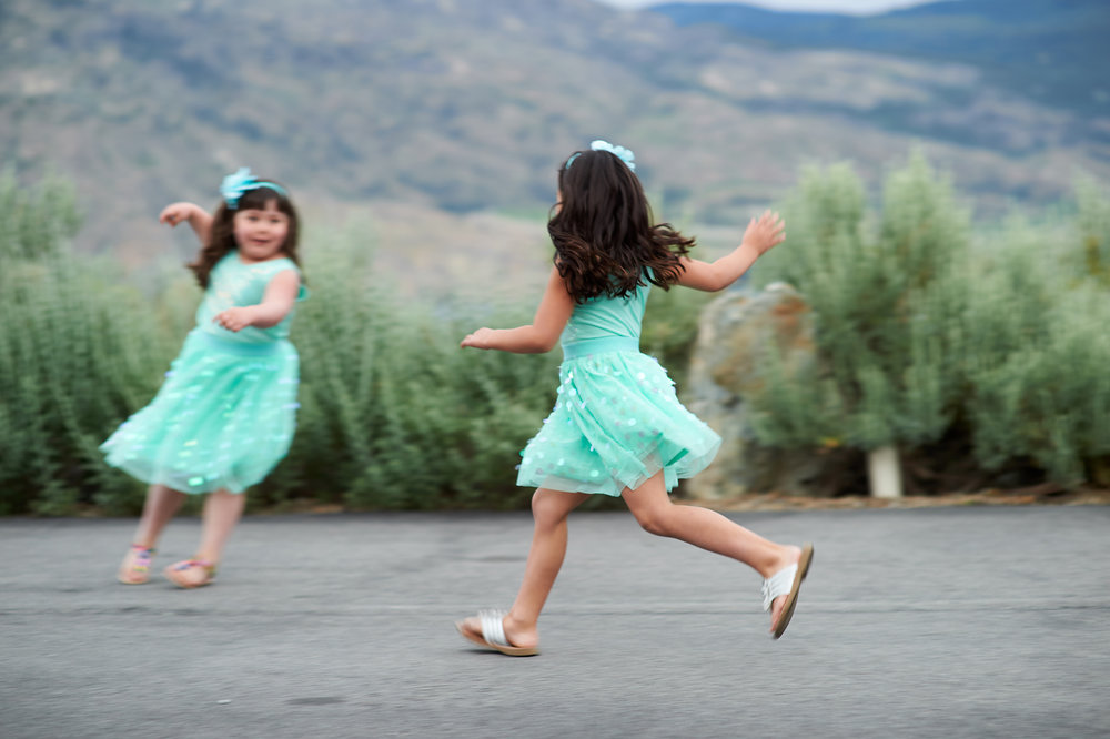 two flower girls playing