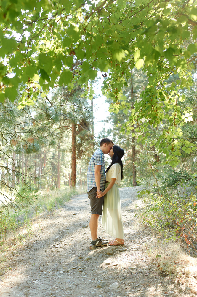 engaged-couple-on-a-sunny-path-in-mission-creek-park.jpg