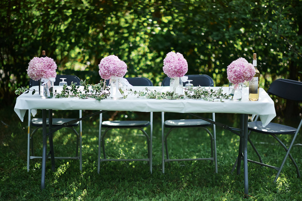 bridal-party-table-decorated-with-flowers.jpg