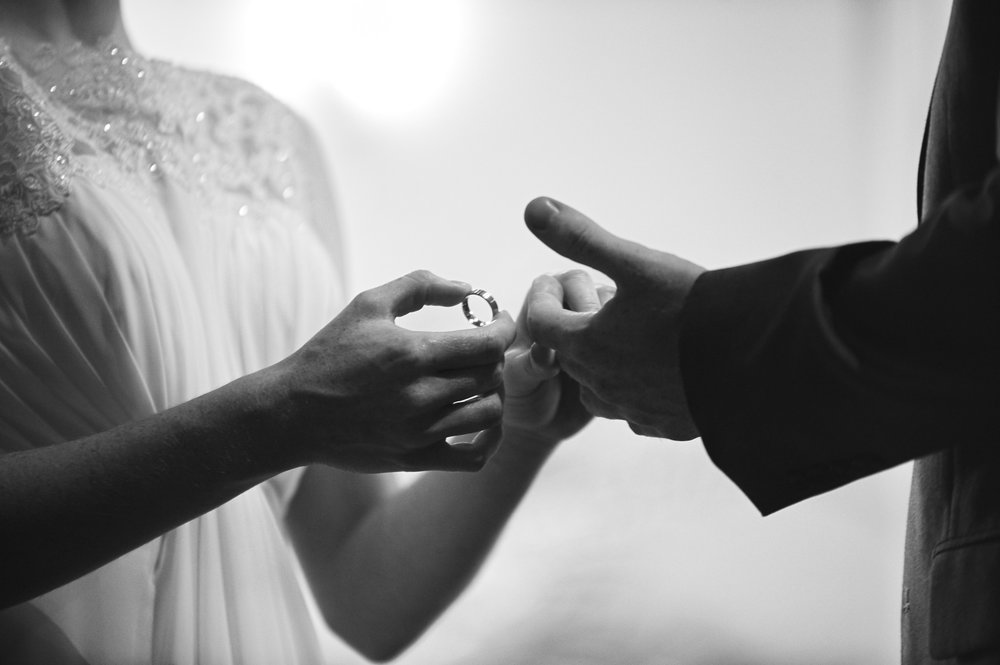 bride-and-groom-exchanging-wedding-rings.jpg