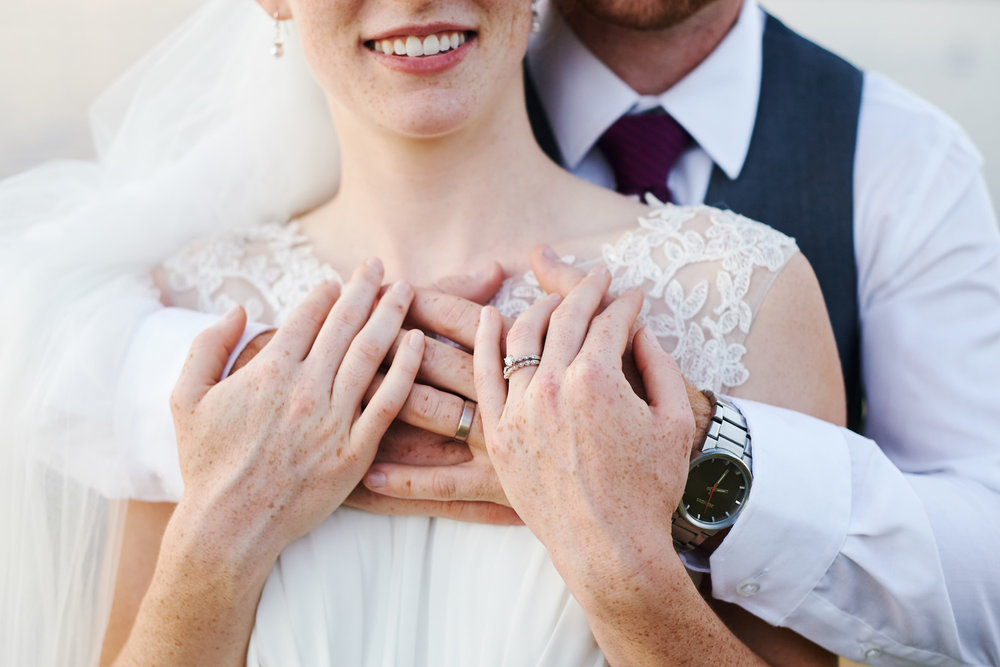 bride-and-groom-formal-portrait-with-wedding-rings.jpg
