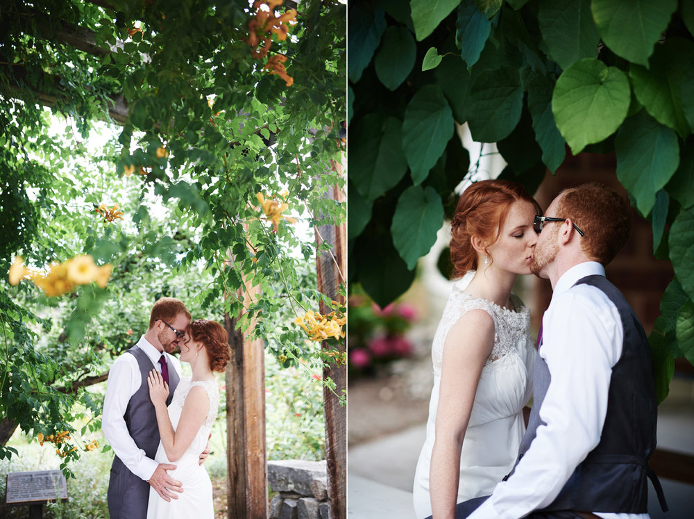 bride-and-groom-in-love-under-a-arch-of-flowers.jpg