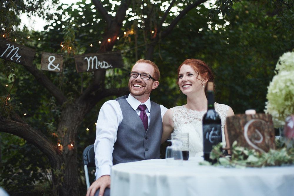 bride-and-groom-listening-to-wedding-speeches.jpg
