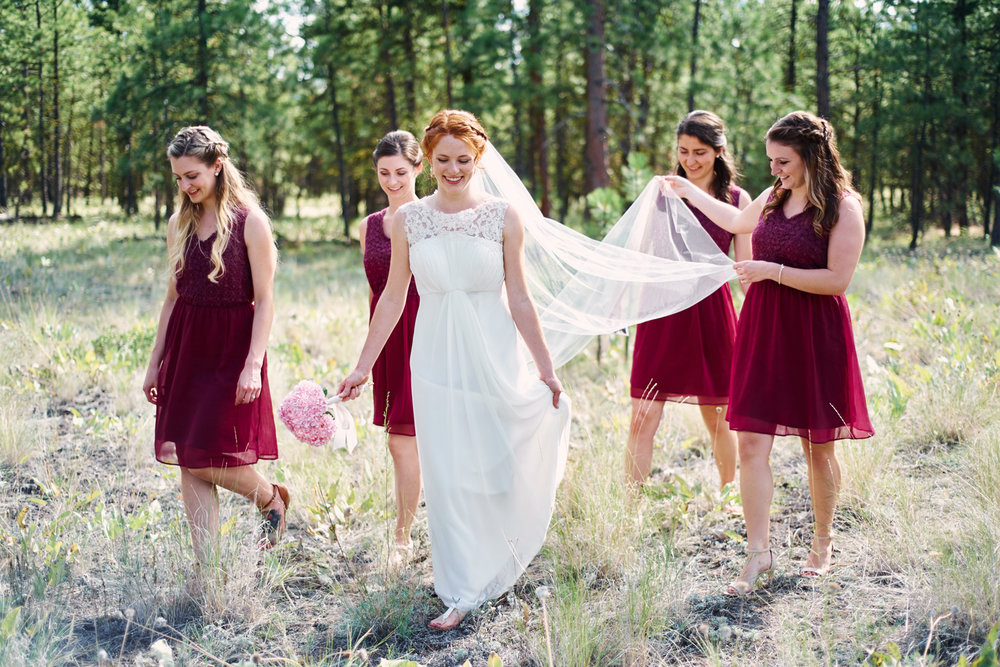 bride-and-her-bridesmaids-walkign-through-the-forest.jpg