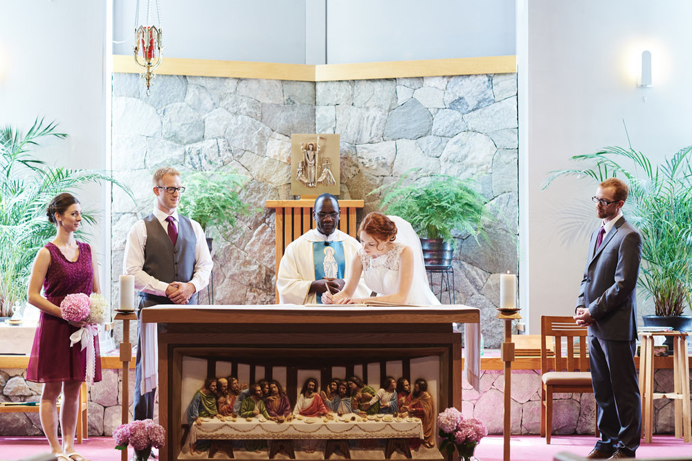 bride-signing-the-register-in-a-roman-catholic-church.jpg