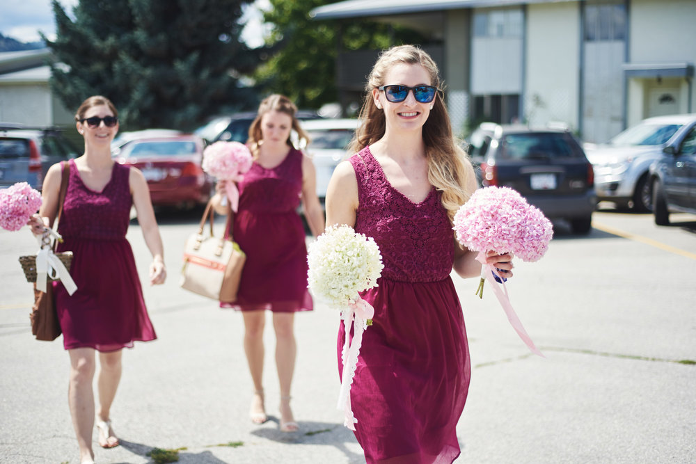bridesmaids-with-their-bouquets-entering-the-church.jpg