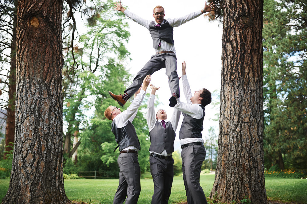 fun-groomsmen-photo-tossing-the-groom-into-the-air.jpg