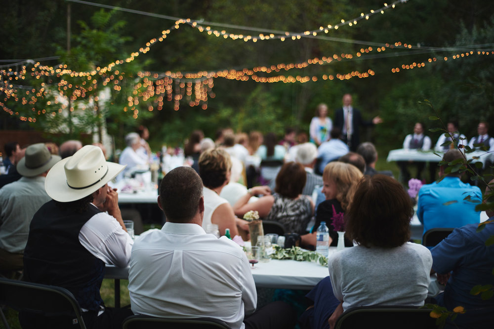rustic-backyard-wedding-reception-with-lights.jpg