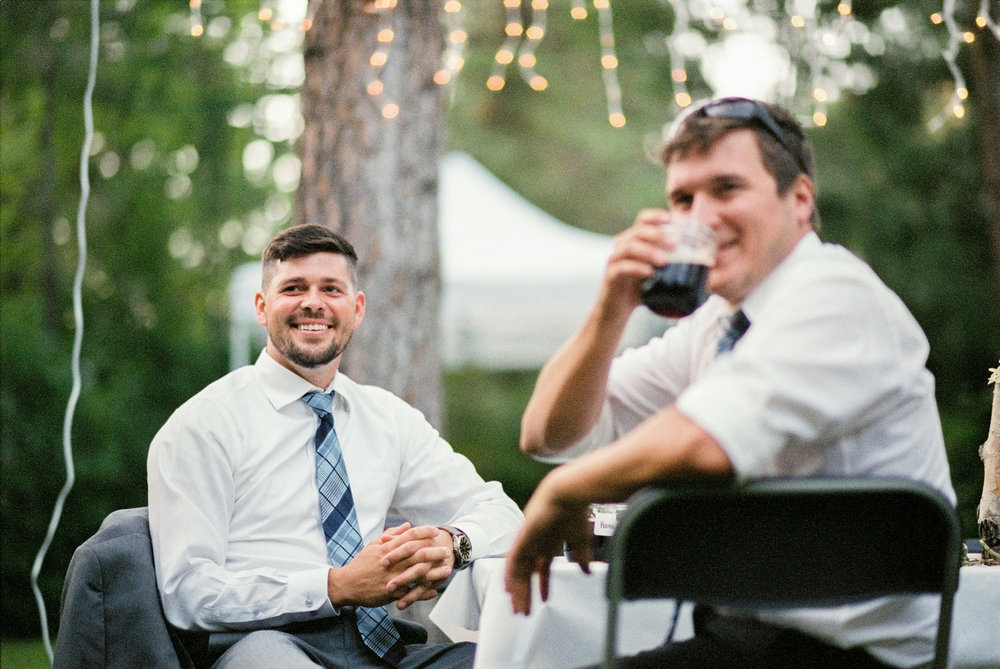 wedding-guests-listenting-to-speeches-at-a-backyard-reception.jpg