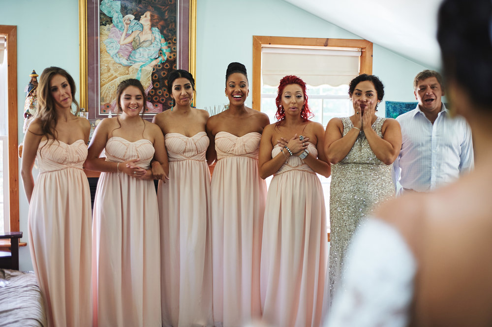 bridal-party-first-look-at-bride's-wedding-dress.jpg