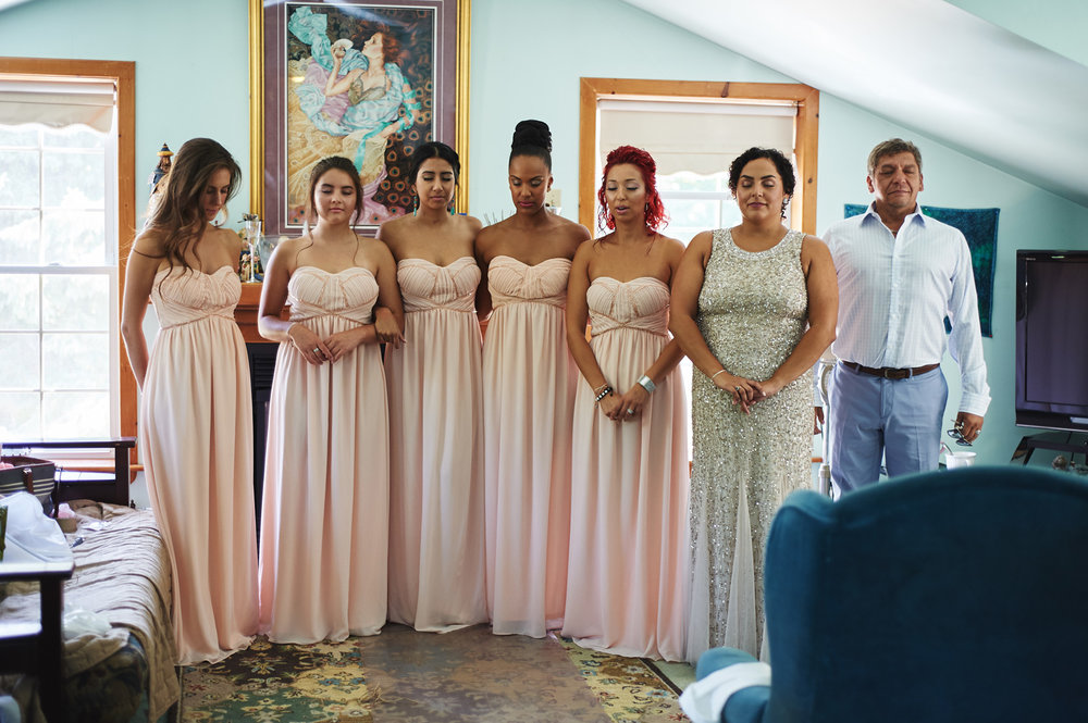 bridal-party-closing-their-eyes-for-the-bride's-reveal.jpg