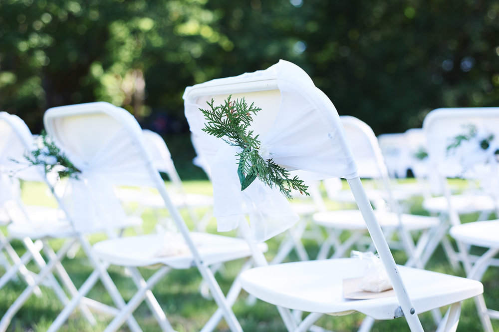 wedding-detail-of-the-ceremony-chairs-outside.jpg